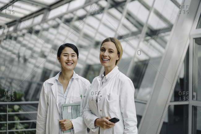 Portrait of two smiling female doctors