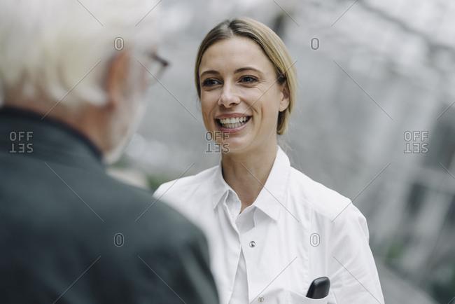 Smiling female doctor talking to senior man