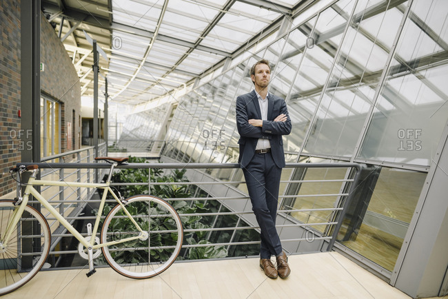 Businessman with bicycle in modern office building