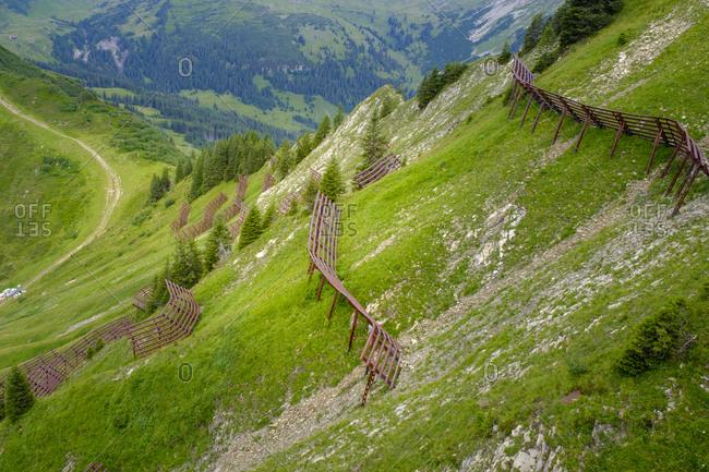 Austria- Vorarlberg- Mittelberg- Mountain ridge secured with avalanche barricades