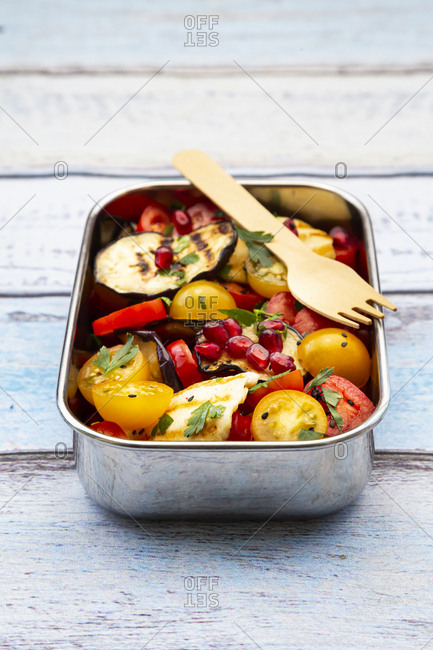 Persian tomato salad with halloumi in metal lunch box