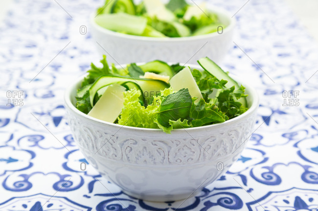 Pea and cucumber salad on patterned table