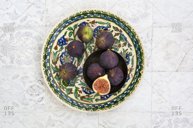 Overhead view of fresh figs on plate