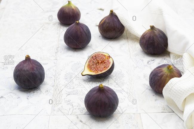 Fresh figs on vintage tiles