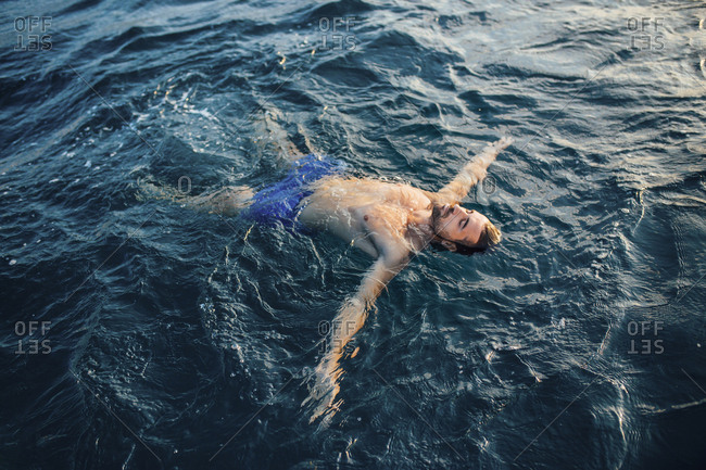 Young man floating on water