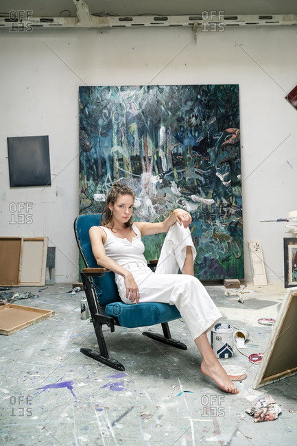 Young artist sitting in her studio