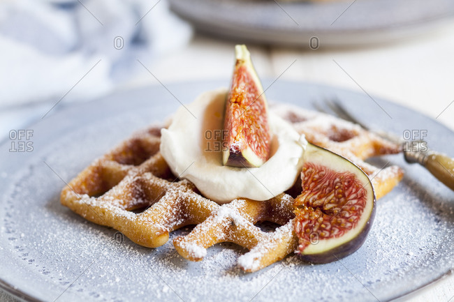 Thick Belgian waffle with whipped cream- powdered sugar and figs
