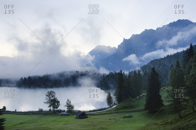 Germany- Bavaria- Mittenwald- Misty morning at Lautersee lake