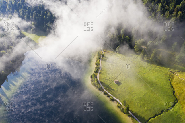 Germany- Bavaria- Mittenwald- Aerial view of fog floating over Ferchensee lake