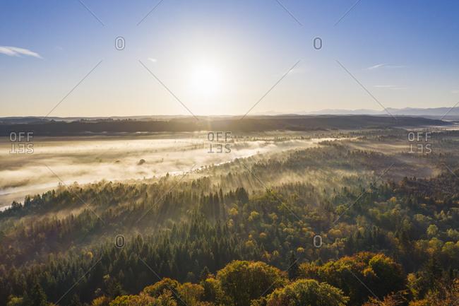 Germany- Bavaria- Upper Bavaria- Nature Reserve Isarauen- Aerial view of Isar river at sunrise