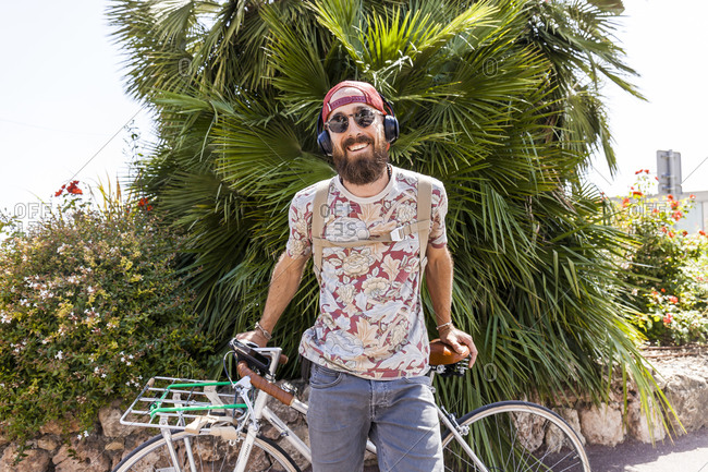 Smiling mature man with bicycle