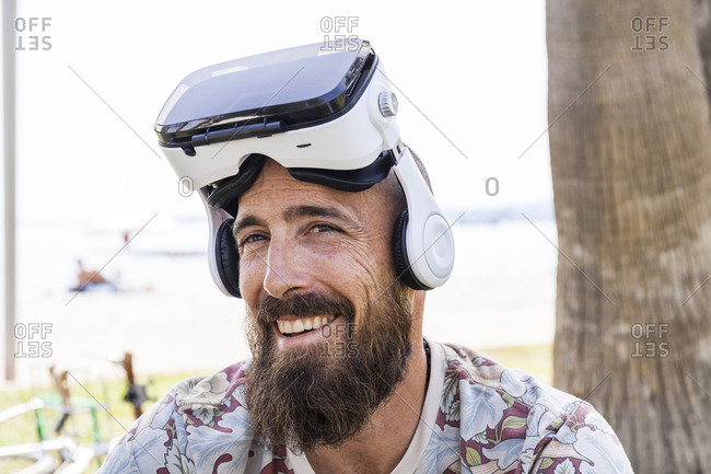 Smiling mature man with virtual reality glasses