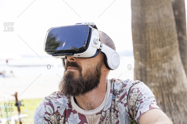 Mature man with virtual reality glasses