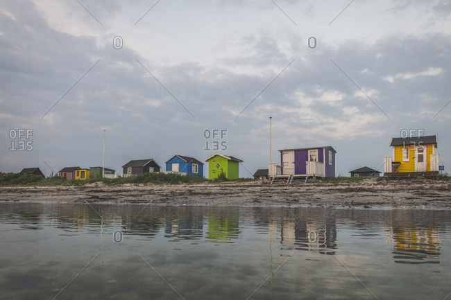 Denmark- Aeroe- Aeroskobing- Traditional baths on beach seen from water