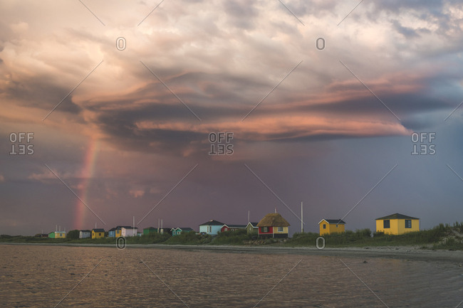 Denmark- Aeroe- Marstal- Storm clouds over traditional waterfront baths