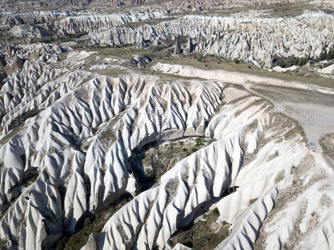 Aerial view of volcanic landscape in Cappadocia during sunny day- Turkey