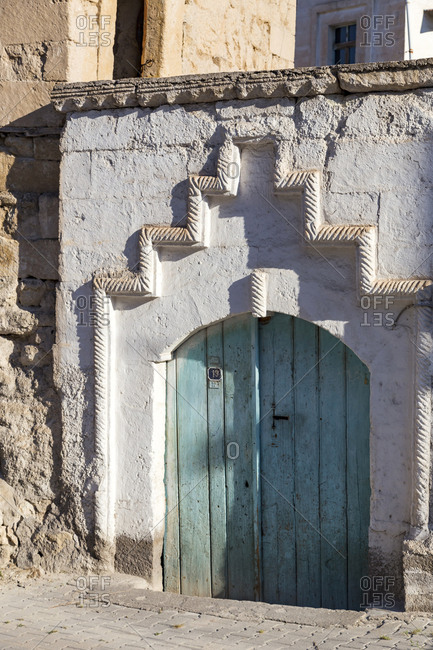 Closed wooden door of house in Göreme city during sunny day- Cappadocia