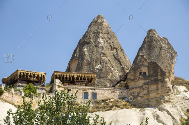 Low angle view of house and rock formation in Göreme city against clear sky- Cappadocia