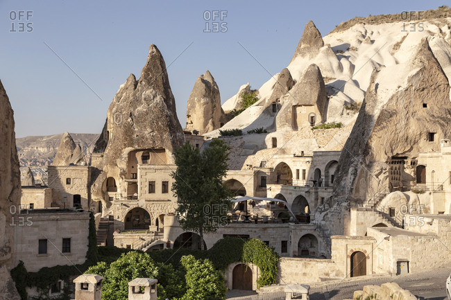Houses and rock formations at Göreme city against clear sky- Cappadocia