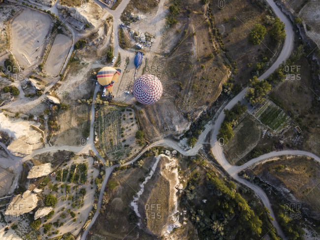 Aerial view of hot air balloons on land at Goreme National Park- Cappadocia- Turkey
