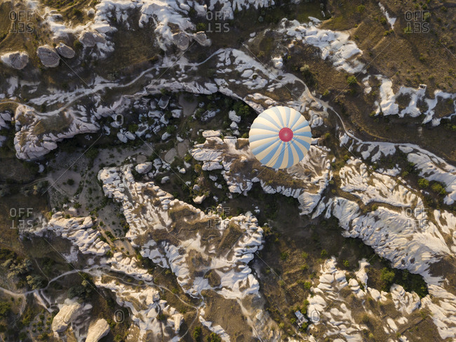 Aerial view of hot air balloon flying over rock formations at Goreme National Park- Cappadocia- Turkey