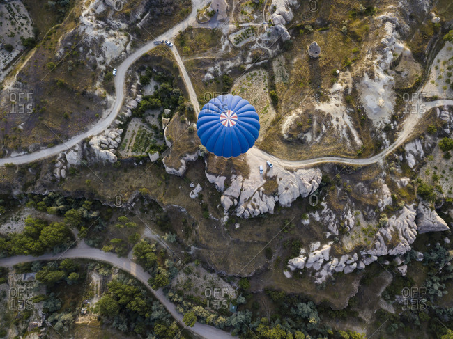 Aerial view of hot air balloon flying over land at Goreme National Park- Cappadocia- Turkey