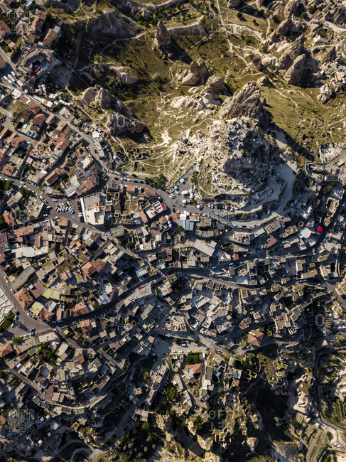 Drone shot of Uchisar castle and buildings in Cappadocia- Turkey