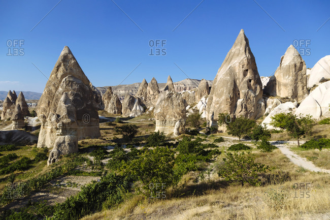 Scenic view of Dove complex monastery against clear blue sky- Cappadocia- Turkey