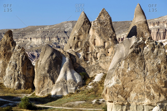 Scenic view of Dove complex monastery against clear blue sky at Goreme- Cappadocia- Turkey