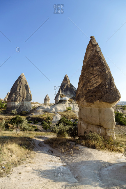 Scenic view of Dove complex monastery against clear blue sky at Goreme National Park- Cappadocia- Turkey