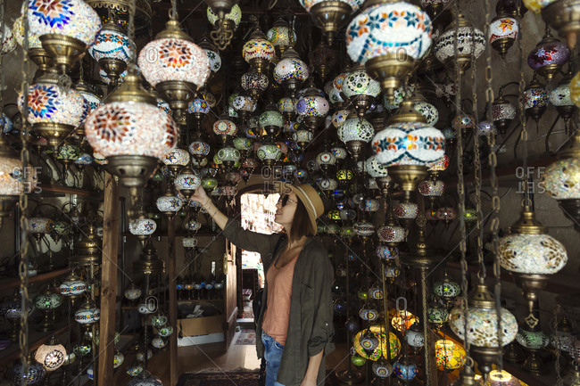 Side view of young woman choosing lanterns in store- Cappadocia- Turkey