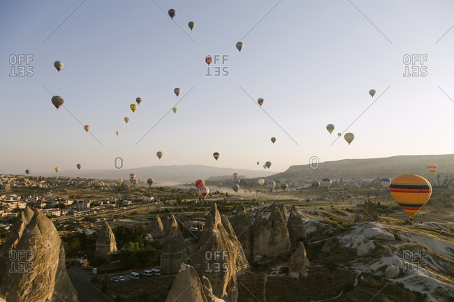 Colorful hot air balloons flying at Goreme National Park during sunset- Cappadocia- Turkey