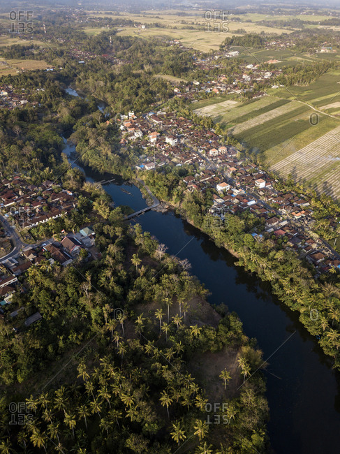 Aerial view of river amidst trees in town at Bali- Indonesia