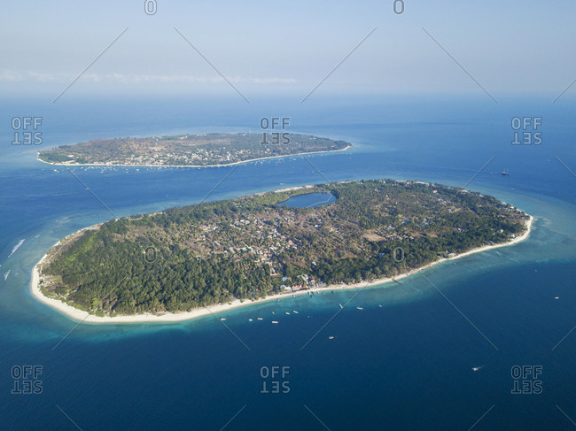 Aerial view of Gili Islands against sky during sunny day at Bali- Indonesia