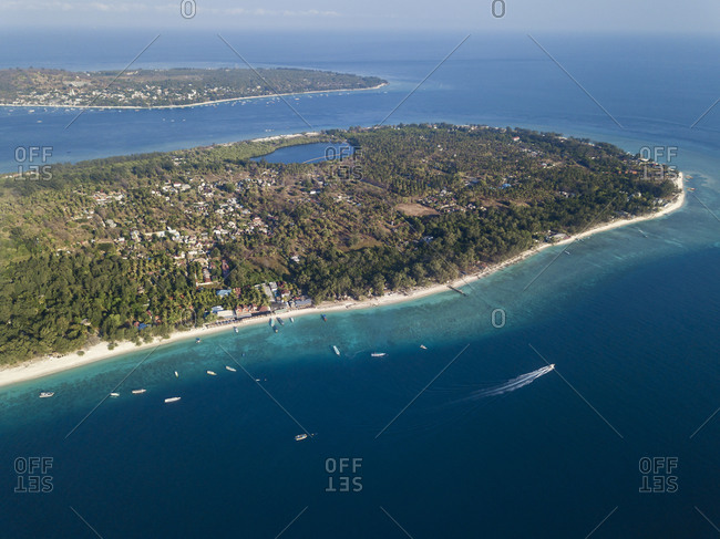 Aerial view of Gili Islands against sky during sunny day- Bali- Indonesia