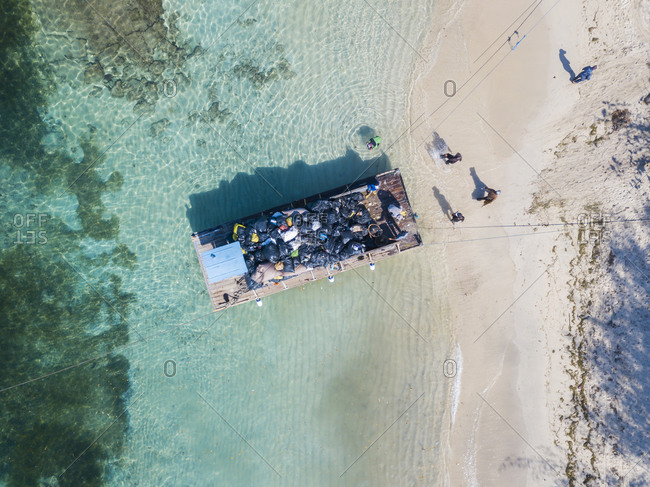 Aerial view of pontoon transporting garbage at Gili Islands- Bali- Indonesia