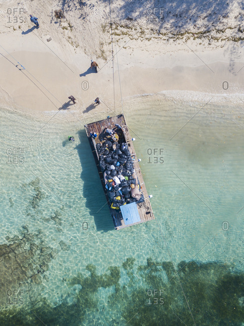 Drone shot of pontoon transporting garbage at Gili Islands- Bali- Indonesia
