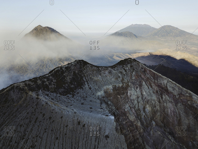 Indonesia- Java- Aerial view of smoke floating over mountains surrounding Ijen volcano