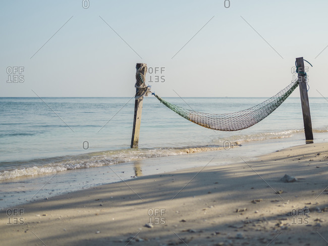 Indonesia- Bali- Gili Islands- Gili Air- Fishing net hammock on beach seen on peaceful day