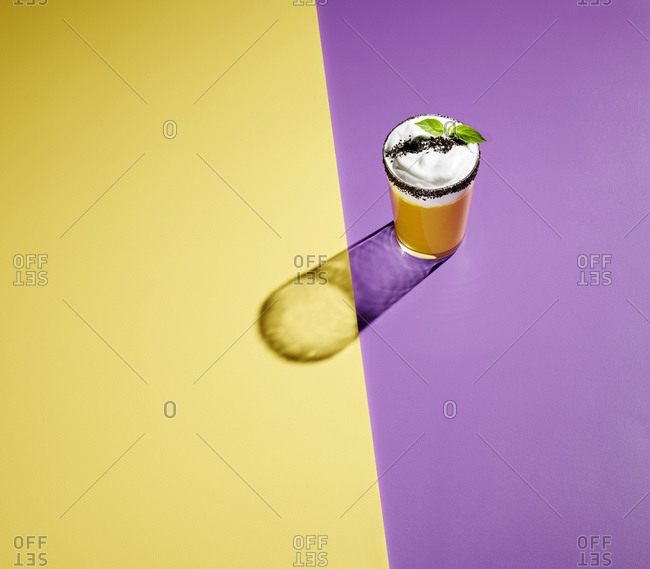High angle view of cocktail on colored background