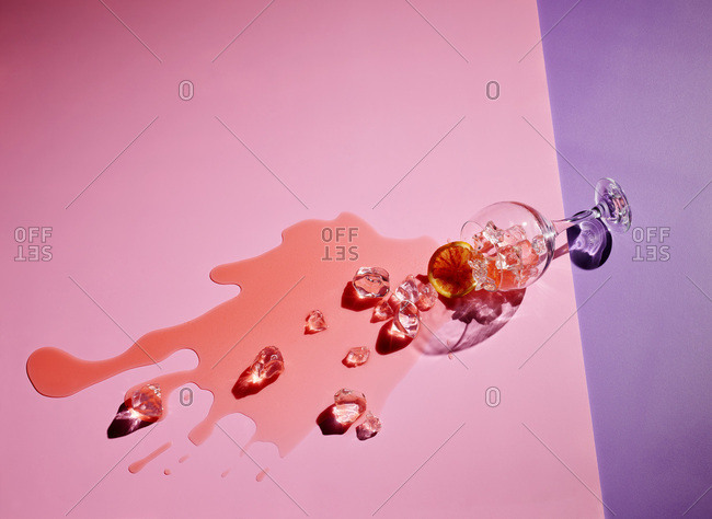 High angle view of drink fallen on colored background