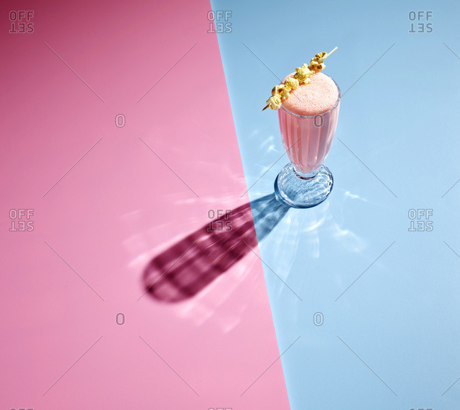 High angle view of milkshake on colored background