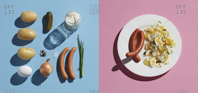 Directly above shot of healthy meal by ingredient in plate with fork on colored background