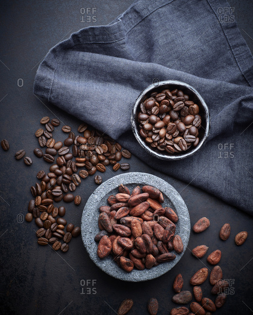 Bowls of cocoa and coffee beans
