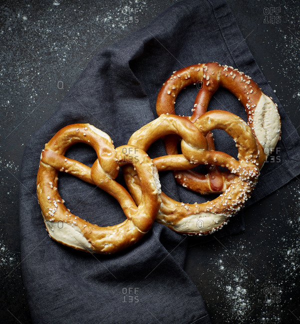 Salty pretzels on tablecloth