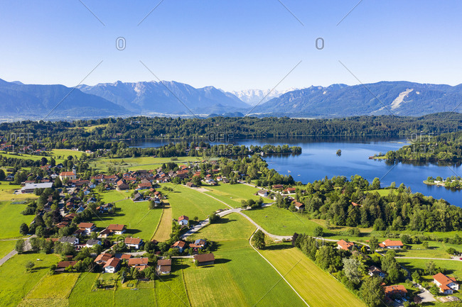 Idyllic view of village at by Staffelsee lake at Seehausen against clear blue sky- Germany
