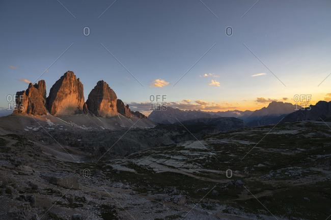 Scenic view of Tre Cime Di Lavaredo against sky at sunset- Italy