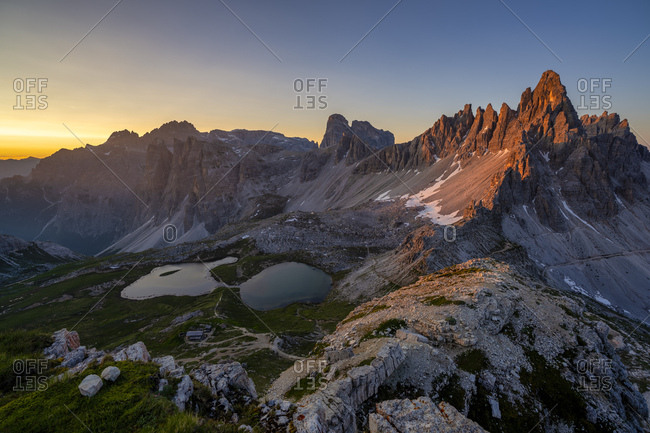 Scenic view of Tre Cime Di Lavaredo and Paternkofel against clear sky at sunset- Italy