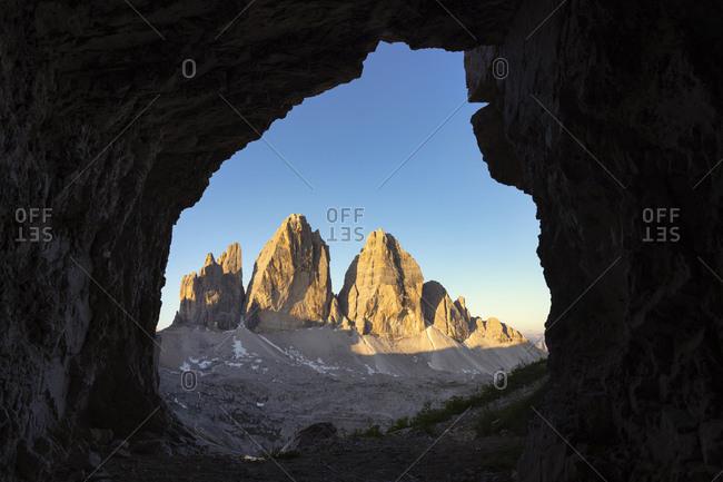 Scenic view of Tre Cime Di Lavaredo against clear sky seen through cave- Veneto- Italy