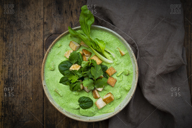 Directly above shot of green curry in bowl on table